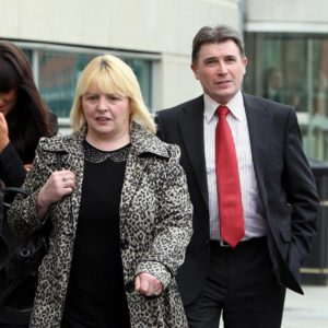 Sally Gribben, sister of Martin McCaughey, and Philip O'Neill, brother in law of Dessie Grew, leave Laganside Court, Belfast