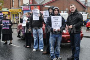 Republican Network for Unity (RNU) members display leaflets and stand in the road during a protest against District Police Partnership meetings being held in the Culturlann McAdam O'Fiaich on the Falls Road in Belfast | © Stephen Barnes, Demotix