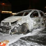 The shell of a torched car after rioting on Friday night at Carnmoney Road, Glengormley. © Pacemaker