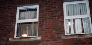 Broken windows of a local business after rioting on the Carnmoney Road, Glengormley. © Pacemaker